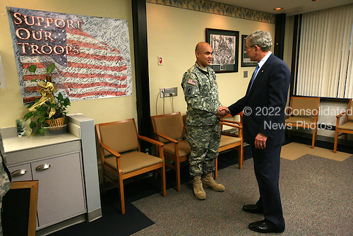 President George W. Bush presents the Purple Heart medal to US Army PFC Jeddah DeLoria of Chosen, Colo., Thursday, Dec. 20, 2007 at the Walter Reed Army Medical Center in Washington, D.C. DeLoria is recovering from injuries sustained in Operation Enduring Freedom in Afghanistan. White House photo by Joyce. N. Bogosian.