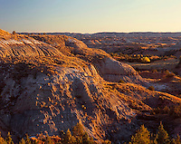 67NDTR_106 - USA, North Dakota, Theodore Roosevelt National Park, North Unit, Sunset light defines eroded sedimentary formations.