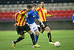 Partick Thistle v St Johnstone....14.12.13    SPFL<br /> David Wotherspoon gets between Gabriel Piccolo and Aaron Taylor-Sinclair<br /> Picture by Graeme Hart.<br /> Copyright Perthshire Picture Agency<br /> Tel: 01738 623350  Mobile: 07990 594431