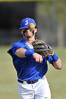Second baseman Oliver Hill (10) of the Spartanburg Methodist College Pioneers warms up before a junior college game against Surry Community College on January 31, 2016, at Mooneyham Field in Spartanburg, South Carolina. (Tom Priddy/Four Seam Images)