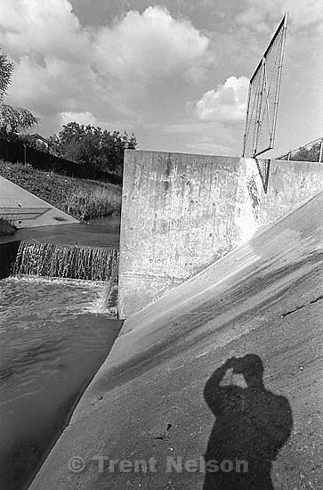 Trent shadow and concrete waterway in the creek.<br />