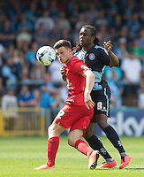 Marcus Bean of Wycombe Wanderers and Reece Thompson in action during the Sky Bet League 2 match between Wycombe Wanderers and York City at Adams Park, High Wycombe, England on 8 August 2015. Photo by Andy Rowland.