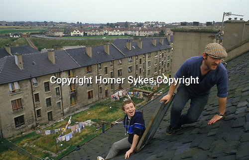 Blackhill estate Glasgow Scotland tenement houses Glasow UK . Young adult unemployed messing around nicking stuff. 1980s 80s