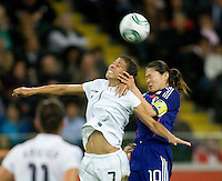 Shannon Boxx (7) of the United States goes up for a header with Homare Sawa (10) of Japan during the final of the FIFA Women's World Cup at FIFA Women's World Cup Stadium in Frankfurt Germany.  Japan won the FIFA Women's World Cup on penalty kicks after tying the United States, 2-2, in extra time.