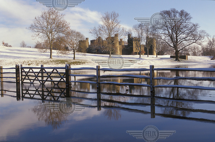 Snow surrounds Bodiam Castle, Robertsbridge, East Sussex.