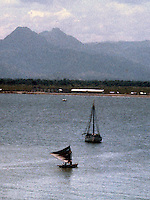 Two boats in the harbor off of Port-Au-Prince, Haiti, 1981.  (Photo by Edward Cleary/www.bcpix.com)