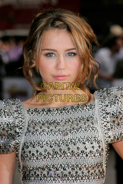 "MILEY CYRUS .UK Premiere of ""Hannah Montana: The Movie"" at the Odeon Leicester Square, London, England. .April 23rd 2009 .headshot portrait silver grey gray beaded beads embellished jewel encrusted shoulder pads structured shoulders sculpted .CAP/AH.©Adam Houghton/Capital Pictures."