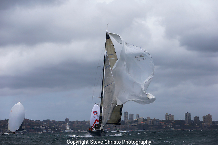 2012 SOLAS Big Boat Challenge on Sydney Harbour, Ocean racer Quest drops her spinnaker at the top marker.Sydney Australia. 11th December  2012. Photo Steve Christo