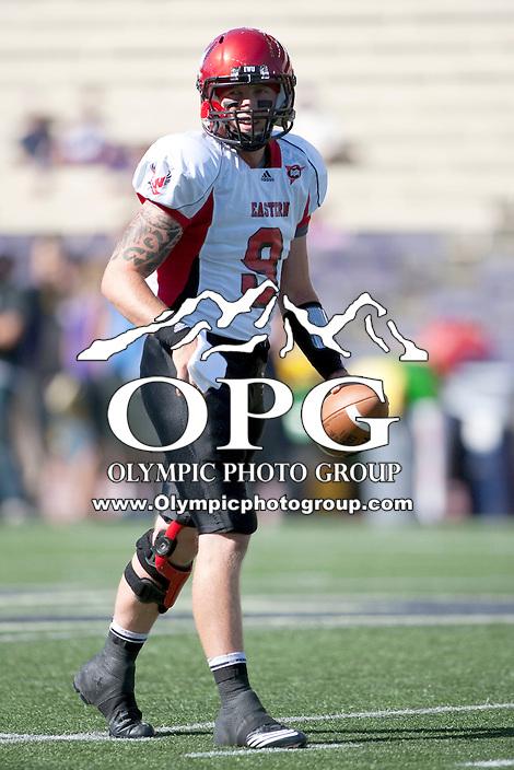Sept 3, 2011:  Eastern Washington quarterback #9 Bo Levi Mitchell warms up before the game against Washington.  Washington defeated Eastern Washington 30-27 at Husky Stadium in Seattle, Washington...