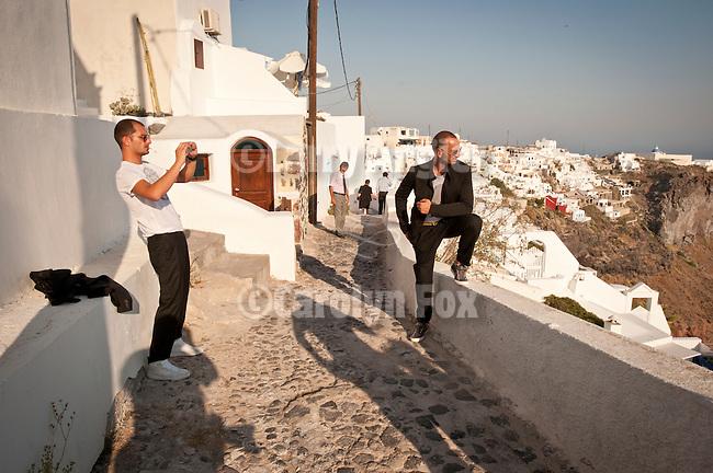 Tourists photograph for their memories, Imerovighli, Santorini, Greece