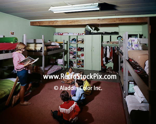 Teenage girl telling story to children at the Victor Van's Hideaway Ranch / Shadow Mountain in East Jewett, New York