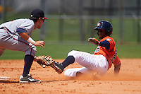GCL Astros outfielder Bryan De La Cruz (36) slides into second as Alejandro Salazar (2) looks to apply the tag during a game against the GCL Braves on July 23, 2015 at the Osceola County Stadium Complex in Kissimmee, Florida.  GCL Braves defeated GCL Astros 4-2.  (Mike Janes/Four Seam Images)