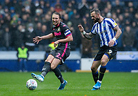 Leeds United's Luke Ayling competing with Sheffield Wednesday's Steven Fletcher (right) <br /> <br /> Photographer Andrew Kearns/CameraSport<br /> <br /> The EFL Sky Bet Championship - Sheffield Wednesday v Leeds United - Saturday 26th October 2019 - Hillsborough - Sheffield<br /> <br /> World Copyright © 2019 CameraSport. All rights reserved. 43 Linden Ave. Countesthorpe. Leicester. England. LE8 5PG - Tel: +44 (0) 116 277 4147 - admin@camerasport.com - www.camerasport.com