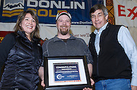 Aaron Burmeister (center) recieves the Bristol Bay Native Corporation Fish First award from Shawn Asplund and Andria Agli at the finishers banquet in Nome on Sunday  March 22, 2015 during Iditarod 2015.  <br /> <br /> (C) Jeff Schultz/SchultzPhoto.com - ALL RIGHTS RESERVED<br />  DUPLICATION  PROHIBITED  WITHOUT  PERMISSION