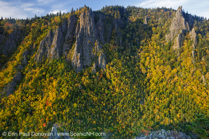 The cliffs of Dixville Notch State Park in New Hampshire from a scenic viewpoint along the Sanguinary Ridge Trail during the autumn months.