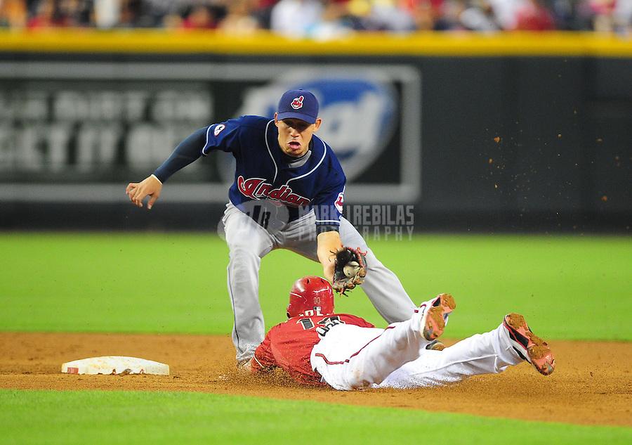 Jun. 29, 2011; Phoenix, AZ, USA; Arizona Diamondbacks base runner Ryan Roberts steals second base ahead of the tag from Cleveland Indians shortstop Asdrubal Cabrera in the second inning at Chase Field. Mandatory Credit: Mark J. Rebilas-