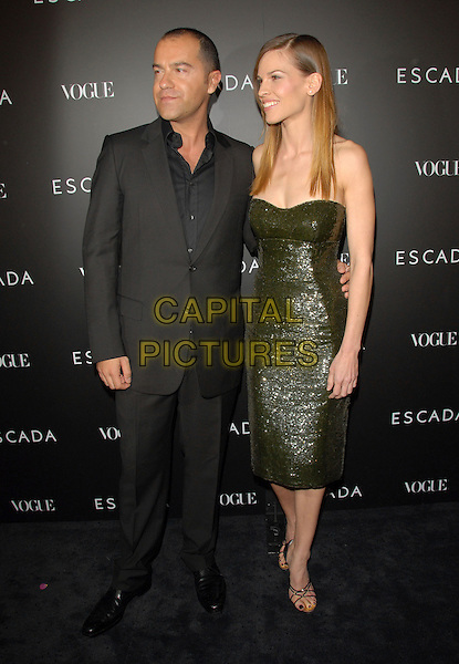 DAMIANO BIELLA & HILARY SWANK.The Grand Opening of The Escada Beverly Hills Flagship Boutique at The Beverly Wilshire Hotel in Beverly Hills, California, USA. .May 3rd, 2007.full length green sequins sequined dress strapless black suit.CAP/DVS.©Debbie VanStory/Capital Pictures