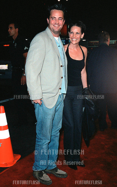 "13OCT99:  ""Friends"" star MATTHEW PERRY & girlfriend RENE ASHTON at the Los Angeles premiere of ""The Story of Us"" which stars Bruce Willis & Michelle Pfeiffer..© Paul Smith / Featureflash"