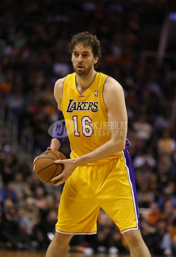 Jan. 30, 2013; Phoenix, AZ, USA: Los Angeles Lakers forward Pau Gasol (16) against the Phoenix Suns at the US Airways Center. Mandatory Credit: Mark J. Rebilas-