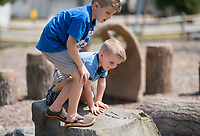 NWA Democrat-Gazette/CHARLIE KAIJO Phoenix Lambert, 5 and Gavin Lambert, 3 of Bella Vista play at the park at Centerton City Hall in Centerton, AR on Friday, September 7, 2017. Centerton residents will decide Tuesday if they want to extend a one-cent sales tax to pay for road improvements, park development and a new city hall.