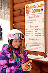 On Thanksgiving Day a snowboarder feasts at Kiilington's  Waffle Hut.