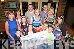 Family and friends of Down Syndrome Ireland, Kerry branch, receiving a cheque from the Cellar Bar, Abbeyfeale last Friday night who fund raised by holding a weight loss challenge. Seated l-r: Sean White, Jessica Power, Darragh Murphy, Dale O'Carroll. Standing l-r: Sheila Power, Eileen Stryker, Maria Power, Larry Keane, Claudette O'Carroll, Paul O'Carroll, Margaret Burke and Rebeca Stryker.