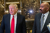 President-elect Donald Trump (L) and media host Steve Harvey (R) are seen in the lobby of Trump Tower in New York, NY, USA on January 13, 2017.  Credit: Albin Lohr-Jones / Pool via CNP