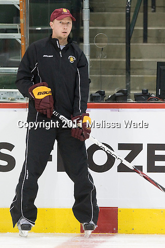 Derek Plante (Duluth - Assistant Coach) - The University of Minnesota-Duluth Bulldogs practiced during the second Frozen Four practice time slot on the Xcel Energy Center ice on Wednesday, April 6, 2011, in St. Paul, Minnesota.