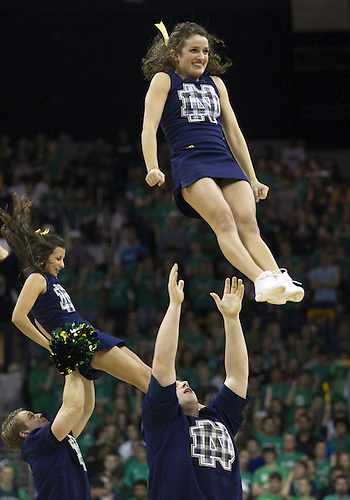 February 09, 2013:  Notre Dame cheerleader Mary Katheryn Snyder performs during NCAA Basketball game action between the Notre Dame Fighting Irish and the Louisville Cardinals at Purcell Pavilion at the Joyce Center in South Bend, Indiana.  Notre Dame defeated Louisville 104-101 in five overtimes.