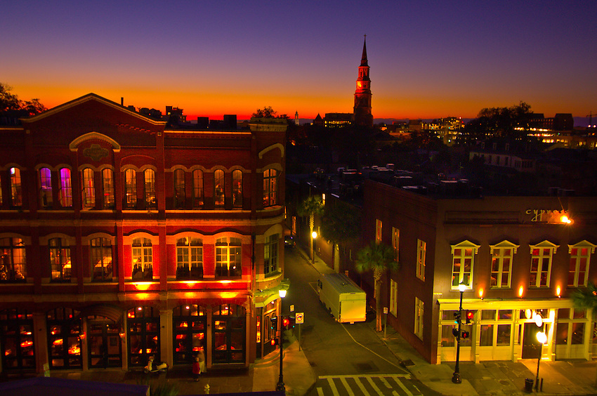 Twilight view of East Bay Street with the steeple of St. Philip's Episcopal Church in background, in the historic district of Charleston, South Carolina