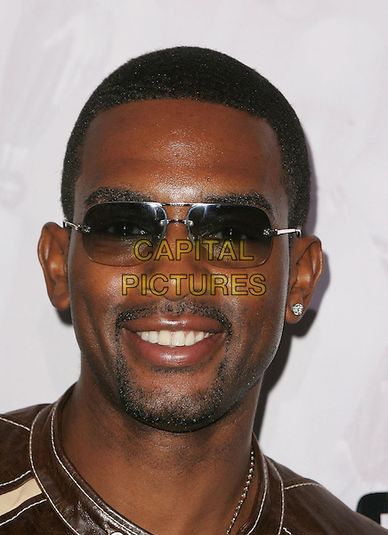 "BILL BELLAMY.Attends Twentieth Century Fox's World Premiere of ""I, Robot"" held at The Mann's Village Theatre in Westwood,.California, July 7th 2004..portrait headshot sunglasses.*UK sales only*.www.capitalpictures.com.sales@capitalpictures.com.©Capital Pictures"