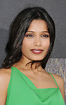 "HOLLYWOOD, CA - JULY 28: Freida Pinto arrives at the ""Rise Of The Planet Of The Apes"" Los Angeles Premiere at Grauman's Chinese on July 28, 2011 in Hollywood, California."