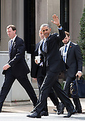 United States President Barack Obama waves to onlookers as he walks with White House Travel Director Marvin Nicholson (left) back to the White House following a luncheon at The Metropolitan Club with former US Senators Tom Daschle (Democrat of South Dakota) and George Mitchell (Republican of Maine) in Washington, DC Monday, October 26, 2015.<br /> Credit: Martin H. Simon / Pool via CNP