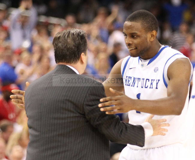 UK senior Darius Miller and head coach John Calipari hug in the second half of the Final Four of the NCAA Tournament, between the University of Kentucky and the University of Louisville, in the Superdome, on Saturday, March 31, 2012 in New Orleans, La. UK won 69-61, advancing to the championship game. Photo by Latara Appleby | Staff
