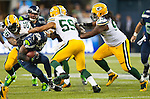 Seattle Seahawks running back Robert Turbin (22) is gang tackled by Green Bay Packers linebackers, Julius Peppers (56), Brad Jones, and defensive tackle Josh Boyd (93) in the NFL Kickoff held at CenturyLink Field in September 4, 2014 in Seattle.  Seattle beat Green Bay 36-16. ©2014   Seattle beat Green Bay 36-16. ©2014  Jim Bryant Photo. ALL RIGHTS RESERVED.
