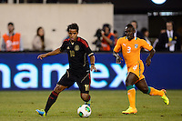 Mexico midfielder Giovani Dos Santos (10) is marked by Ivory Coast defender Arthur Boka (3). Mexico defeated the Ivory Coast 4-1 during an international friendly at MetLife Stadium in East Rutherford, NJ, on August 14, 2013.