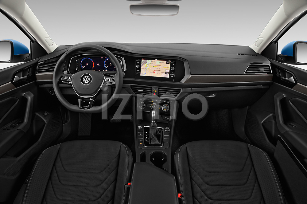 Stock photo of straight dashboard view of a 2019 Volkswagen Jetta SEL Premium 4 Door Sedan
