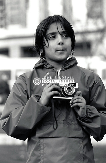Girl with camera UK 1980