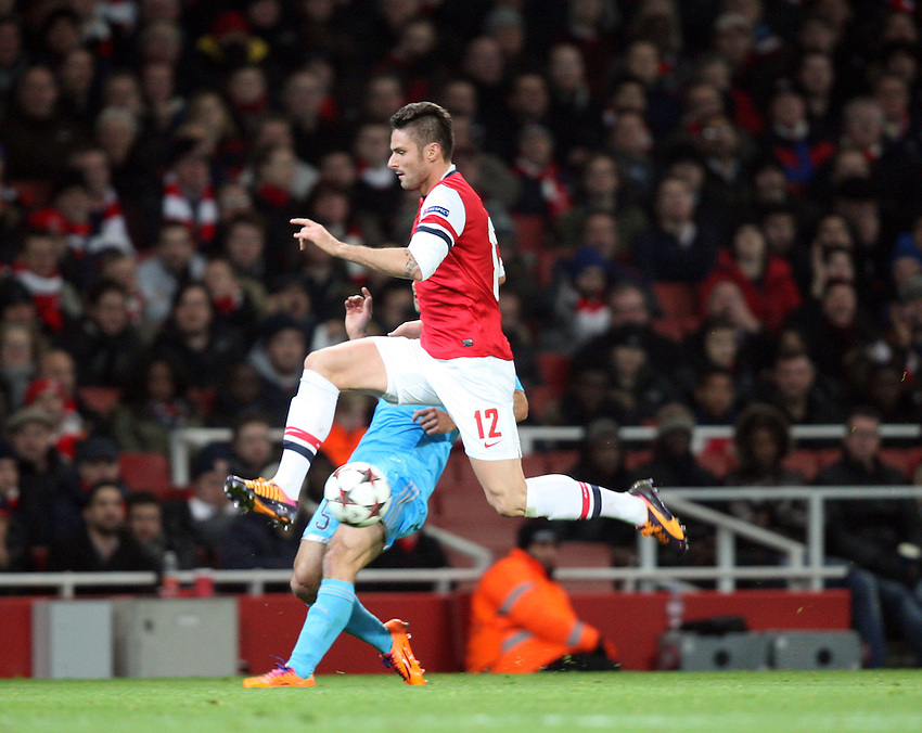 Arsenal's Olivier Giroud in action <br /> Photo by Kieran Galvin/CameraSport<br /> <br /> Football - UEFA Champions League Group F - Arsenal v Marseille - Tuesday 26th November 2013 - The Emirates Stadium - London<br /> <br /> &copy; CameraSport - 43 Linden Ave. Countesthorpe. Leicester. England. LE8 5PG - Tel: +44 (0) 116 277 4147 - admin@camerasport.com - www.camerasport.com