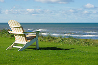 chair on a meadow with a view on the sea