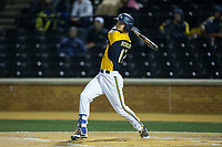 Pete Schuler (17) of the Kent State Golden Flashes follows through on his swing against the Wake Forest Demon Deacons in game two of a double-header at David F. Couch Ballpark on March 4, 2017 in  Winston-Salem, North Carolina.  The Demon Deacons defeated the Golden Flashes 5-0.  (Brian Westerholt/Four Seam Images)