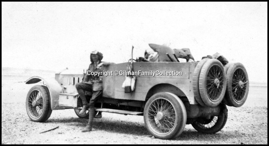 Bournemouth News (01202 558833)<br /> Pic: GilmanFamilyCollection/BNPS<br /> <br /> Commanding Officer Colonel Dawny stands next to a Rolls Royce Tender.<br /> <br /> Fascinating never before seen photos of the Arab Revolt have revealed Lawrence of Arabia actually had help from a plucky band of British troops as well as the Arab tribesmen.<br /> <br /> A new book reveals the legendary campaign, that did much to shape the modern map of the Middle East, used cutting edge weapons like Rolls Royce armoured car's and British crewed aircraft to attack the Turkish enemy alongside the native arab army.<br /> <br /> The photos feature in military historian James Stejskal's new book Masters of Mayhem which sheds new light on T.E Lawrence's achievements fighting alongside Arab guerrilla forces in the Middle East during the First World War.<br /> <br /> They had been tucked away in the private photo albums of the descendants of soldiers who fought alongside Lawrence during the campaign.<br /> <br /> One historically important photo shows Lawrence and his driver sitting in a Rolls Royce in Marjeh Square in Damascus after it was captured in October 1918.<br /> <br /> Another documents the dramatic moment a water tower and windmill pump are blown up in the desert.