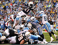 Z.chargers.2A.0601.jl.jpg/photo Jamie Scott Lytle/Chargers LaDainian Tomlinson flies over the line for the touch down in the fourth quarter during the Wildcard agme at the Q in 2008.