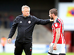 Chris Wilder manager of Sheffield Utd and Kieron Freeman of Sheffield Utd during the English League One match at Glanford Park Stadium, Scunthorpe. Picture date: September 24th, 2016. Pic Simon Bellis/Sportimage