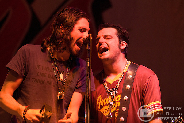 Brothers Micky (left) and Willy Braun perform together during Austin, Texas based band Reckless Kelly's set at Mayfest at LaGrave Field in Fort Worth, Texas on July 12, 2009. ..The July concert was a makeup event after the original festival was canceled amid fears concerning the H1N1 (swine) influenza (Swine flu) outbreak..