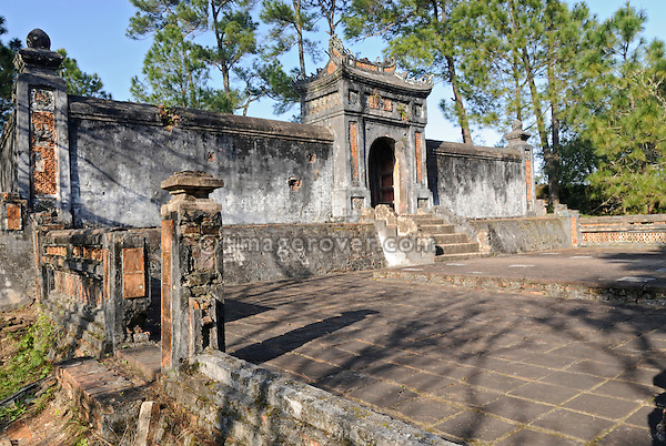 Asia, Vietnam, Hue. Royal tomb of Kien Phuc within the tomb of Tu Duc. Designated a UNESCO World Heritage Site in 1993, Hue is honoured for its complex of historic monuments. Many of them are scattered across the scenic countryside to the south of Hue. Often considered to be the most elegant tomb in Vietnam, the mausoleum of Tu Duc (1848-1883) was designed by the king himself. Set on a pine-forested hill, it is flanked by lotus ponds and frangipani trees.
