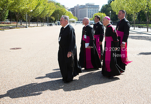 A group of priests depart from an Official State Welcome ceremony for Pope Francis at the White House in Washington, DC on Wednesday, September 23, 2015.  <br /> Credit: Chris Kleponis / CNP