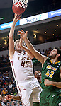 SIOUX FALLS, SD - MARCH 6:  Aaron Brennan #45 of IUPUI shoots a layup over Dylan Miller #43 of North Dakota State in the 2016 Summit League Tournament. (Photo by Dave Eggen/Inertia)