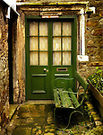 A doorway and a bench at a cottage