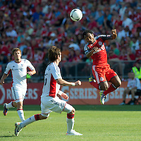 23 June 2011: Toronto FC midfielder Julian de Guzman #6 and New England Revolution defender/midfielder Stephen McCarthy #26 in action during an MLS game between the New England Revolution and the Toronto FC at BMO Field in Toronto.